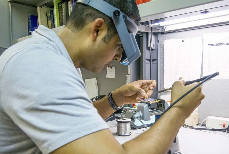Graduate student works in the Castle Commerce Center lab