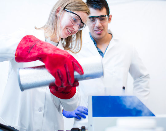 Two students conducting a chemistry experience.